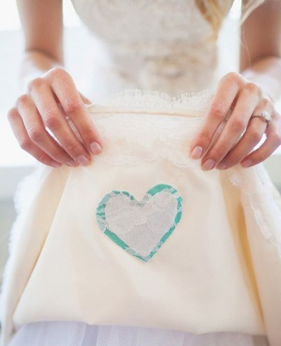 Sew-a-Piece-of-Clothing-onto-your-wedding-dress